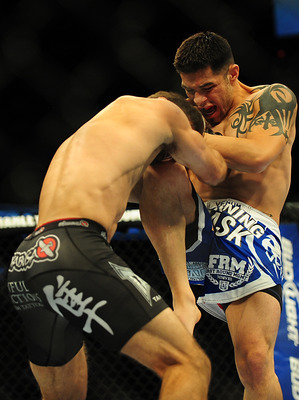 Jul 21, 2012; Calgary, AB, CANADA; Daniel Pineda (blue shorts) during the featherweight bout of UFC 149 against Antonio Carvalho (black shorts) at the Scotiabank Saddledome. Mandatory Credit: Anne-Marie Sorvin-US PRESSWIRE