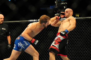 Jul 21, 2012; Calgary, AB, CANADA; Mitch Gagnon (black shorts) during the bantamweight bout of UFC 149 against Bryan Caraway (blue shorts) at the Scotiabank Saddledome. Mandatory Credit: Anne-Marie Sorvin-US PRESSWIRE