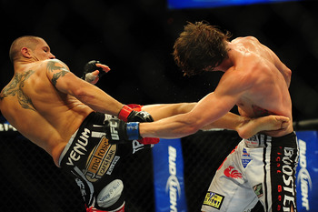 Jul 21, 2012; Calgary, AB, CANADA; Chris Clements (red gloves) and Matt Riddle (blue gloves) during the welterweight bout of UFC 149  at the Scotiabank Saddledome. Mandatory Credit: Anne-Marie Sorvin-US PRESSWIRE
