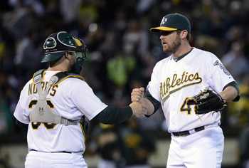 Derek Norris (left) congratulates Ryan Cook