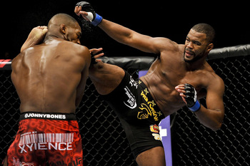 Apr 21, 2012; Atlanta, GA, USA; Jon Jones fights (red trunks) fights Rashad Evans in the main event and light heavyweight title bout during UFC 145 at Philips Arena. Mandatory Credit: Paul Abell-US PRESSWIRE