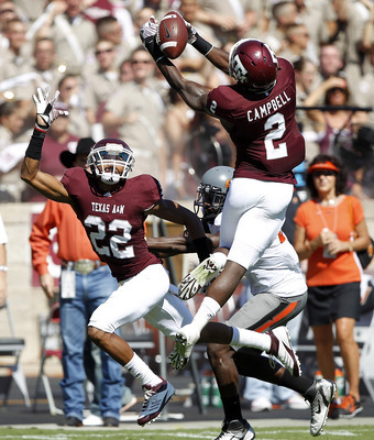 COLLEGE STATION, TX - SEPTEMBER 24:  Defensive back Steve Campbell #2 of the Texas A&M Aggies has the ball go through his hands as he defends on a pass meant for wide receiver Justin Blackmon #81 of Oklahoma State Cowboys as Dustin Harris #22 looks for a