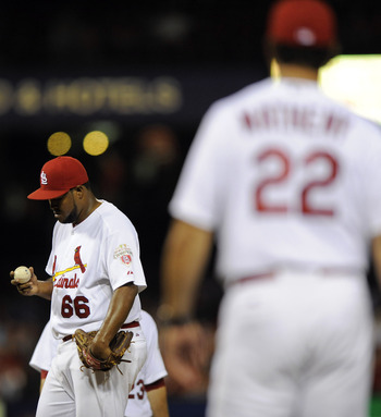 Manager Mike Matheny (22) has made too many long walks to the mound to hook pitchers like Victor Marte (66) in middle relief of close games.