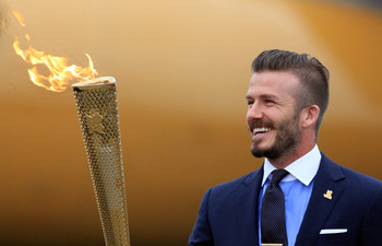 David Beckham with the Olympic torch in Greece in May 2012
