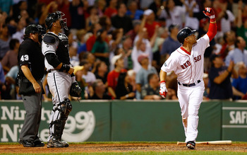 BOSTON, MA - JULY 19:  Cody Ross #7 of the Boston Red Sox drops his bat and watches the ball after hitting the game winning walk-off three run home run in the bottom of the ninth inning against the Chicago White Sox during the game on July 19, 2012 at Fen