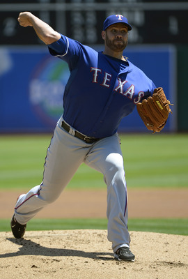 Colby Lewis' season-ending elbow injury increases the Rangers' urgency to land an impact starter.