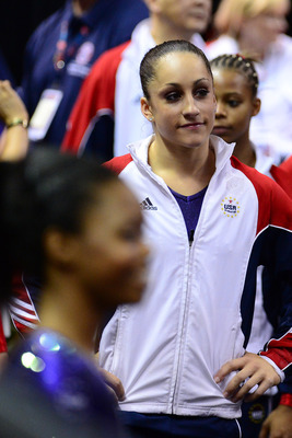 Jordyn Wieber looking on as Gabby Douglas receives congratulations for her Olympic Trials win