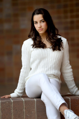 Aly Raisman poses for a shoot at the 2012 Media Summit
