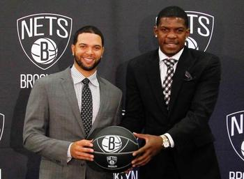 Deron Williams (Left) & Joe Johnson (via thephoenixmag.com)