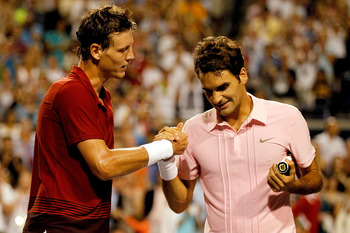 TORONTO, ON - AUGUST 13:  Tomas Berdych of the Czech Republic congratulates Roger Federer of Switzerland after their match during the quarterfinals of the Rogers Cup at the Rexall Centre on August 13, 2010 in Toronto, Canada.  (Photo by Matthew Stockman/G