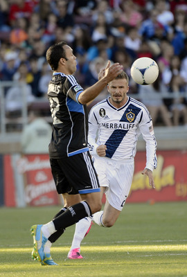 PALO ALTO, CA - JUNE 30:  Ramiro Corrales #12 of the San Jose Earthquakes dribbles the ball off his chest away from David Beckham #23 of the Los Angeles Galaxy at Stanford Stadium on June 30, 2012 in Palo Alto, California. The Earthquakes won the game 4-3