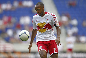 HARRISON, NJ - JULY 18:  Thierry Henry #14 of the New York Red Bulls protects the ball against the Chicago Fire during their match at Red Bull Arena on July 18, 2012 in Harrison, New Jersey.  (Photo by Jeff Zelevansky/Getty Images)