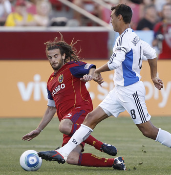 SANDY, UT - JULY 23: Kyle Beckerman #5 of Real Salt Lake dives for the ball to try and stop Chris Wondolowski #8 of San Jose Earthquakes during the first half of an MLS soccer game July 23, 2011 at Rio Tinto Stadium in Sandy, Utah. (Photo by George Frey/G