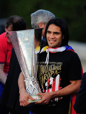 MADRID, SPAIN - MAY 10:  Radamel Falcao of Atletico Madrid holds the Europa League trophy while celebrating with fans at Plaza Neptuno a day after Atletico won the Europa League Final on May 10, 2012 in Madrid, Spain. Atletico beat Athletic Bilbao 3-0 in 