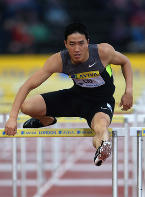 LONDON, ENGLAND - JULY 13:  Liu Xiang of China in action in the 110m hurdles during day one of the Aviva London Grand Prix at Crystal Palace on July 13, 2012 in London, England.  (Photo by Julian Finney/Getty Images)