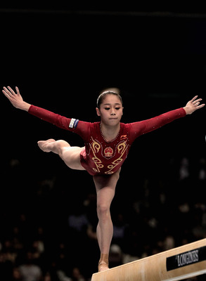 TOKYO, JAPAN - OCTOBER 16:  Sui Lu of China competes in the Balance Beam final during day ten of the Artistic Gymnastics World Championships Tokyo 2011 at Tokyo metropolitan Gymnasium on October 16, 2011 in Tokyo, Japan.  (Photo by Lintao Zhang/Getty Imag