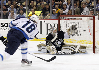 PITTSBURGH, PA - MARCH 20:  Bryan Little #18 of the Winnipeg Jets shoots and scores past Brad Thiessen #39 of the Pittsburgh Penguins during the game at Consol Energy Center on March 20, 2012 in Pittsburgh, Pennsylvania.  (Photo by Justin K. Aller/Getty I