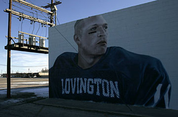 Brian Urlacher's image is painted on a wall in his hometown of Lovington, NM, where he still donates large portions of his time and money to improve his former high school football program. Photo credit: Toby Jorrin for USA TODAY