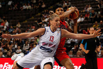 MANCHESTER, ENGLAND - JULY 18: Jo Leedham (L) of Standard Life Team Great Britain in action with Angel McCoughtry of the USA during the match between Standard Life Team Great Britain and the USA at the MEN Arena on July 18, 2012 in Manchester, England. (P
