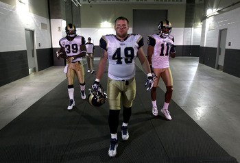 Fullback Brit Miller (49) walks out to the tunnel last season and is trailed by running back Steven Jackson (39) and wide receiver Brandon Gibson.