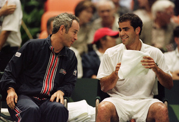 7 Apr 2000: Pete Sampras of USA and Davis Cup coach John McEnroe find a moment a levity during Sampras'' 7-6, 6-3,6-2 straight set loss to Jiri Novak of the Czech Republic in the quarterfinal matches of the Davis Cup at the Great Western Forum in Los Ange