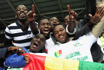 COVENTRY, ENGLAND - APRIL 23:  Fans of Senagal celebrate progressing to the Olympic games during the London 2012 Olympic Qualifier between Senegal and Oman at Ricoh Arena on April 23, 2012 in Coventry, England.  (Photo by Jamie McDonald/Getty Images)