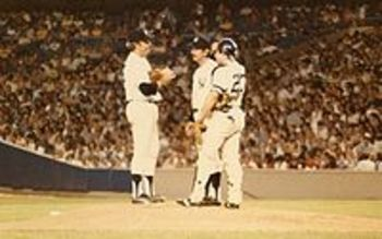 Brad Gulden having a meeting on the mound with Catfish Hunter and Billy Martin via Wikipedia.org