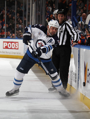 UNIONDALE, NY - APRIL 05: Mark Stuart #5 of the Winnipeg Jets skates against the New York Islanders at the Nassau Veterans Memorial Coliseum on April 5, 2012 in Uniondale, New York. The Islanders defeated the Jets 5-4.  (Photo by Bruce Bennett/Getty Image