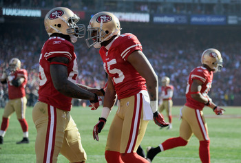 SAN FRANCISCO, CA - JANUARY 14:  Vernon Davis #85 of the San Francisco 49ers celebrates after his touchdown with Michael Crabtree #15 against the New Orleans Saints during the NFC Divisional playoff game at Candlestick Park on January 14, 2012 in San Fran