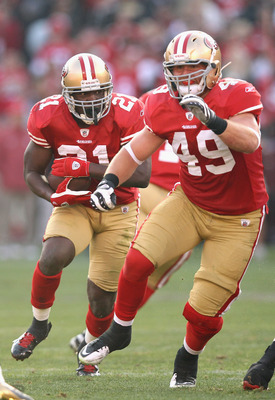 Bruce Miller (49) paves the way for Frank Gore during the NFC Championship game last season..