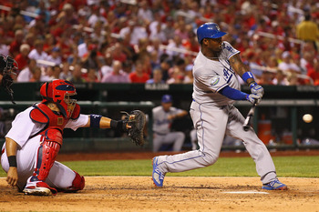 ST. LOUIS, MO - JULY 25: Hanley Ramirez #13 of the Los Angeles Dodgers hits an RBI single against the St. Louis Cardinals at Busch Stadium on July 25, 2012 in St. Louis, Missouri.  The Cardinals beat the Dodgers 3-2 in 12 innings.  (Photo by Dilip Vishwan