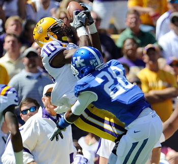BATON ROUGE, LA - OCTOBER 01:  Russell Shepard #10 of the Louisiana State University Tigers catches a pass over Eric Dixon #28 of the Kentucky Wildcats during a game being held at Tiger Stadium on October 1, 2011 in Baton Rouge, Louisiana.  (Photo by Stac