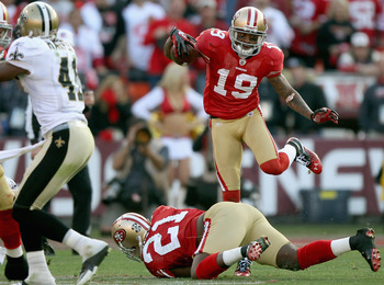 Ted Ginn (19) leapfrogs Frank Gore during San Francisco's playoff victory against New Orleans last season.