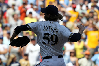 MILWAUKEE, WI - JULY 15: John Axford #59 of the Milwaukee Brewers pitches in the top of the 9th inning against the Pittsburgh Pirates, the Brewers won 4-1 over the Pirates at Miller Park on July 15, 2012 in Milwaukee, Wisconsin. (Photo by Mike McGinnis/Ge