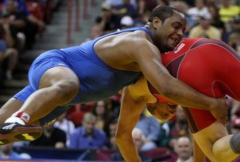 LAS VEGAS - JUNE 15:  Daniel Cormier (blue) takes down Damion Hahn (red) in the Freestyle 96kg division championship match during the USA Olympic trials for wrestling and judo on June 15, 2008 at the Thomas & Mack Center in Las Vegas, Neveda.  (Photo by J