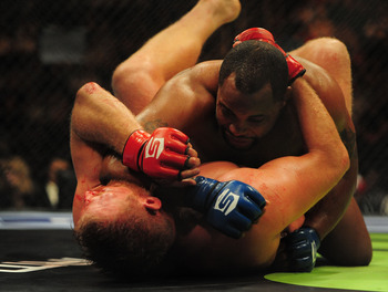 May 19, 2012; San Jose, CA, USA; Josh Barnett (bottom) fights Daniel Cormier (top) during the heavyweight tournament final bout of the Strikeforce World Grand Prix at HP Pavilion.  Mandatory Credit: Kyle Terada-US PRESSWIRE