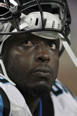 DETROIT, MI - NOVEMBER 20: Charles Johnson #95 of the Carolina Panthers watches the action from the bench during the game against the Detroit Lions at Ford Field on November 20, 2011 in Detroit, Michigan. The Lions defeated the Panthers 49-35.  (Photo by