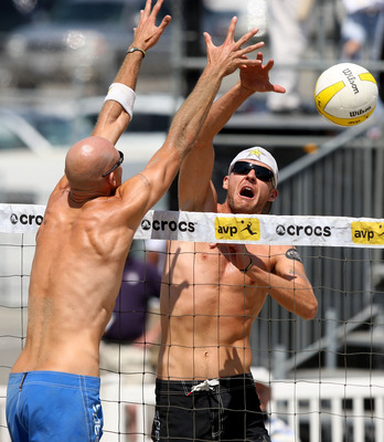 Jake Gibb hits against Phil Dalhausser.