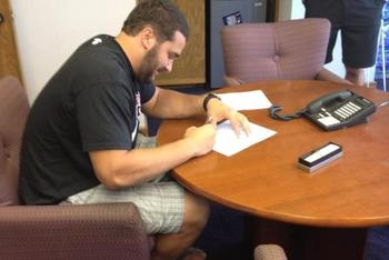 Matt Kalil signing his contract on Thursday morning...