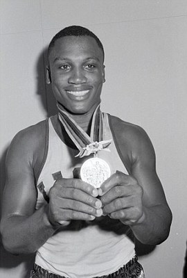 Joe Frazier with his gold medal from the '64 Olympics in Tokyo (Image courtesy of dailymail.co.uk).