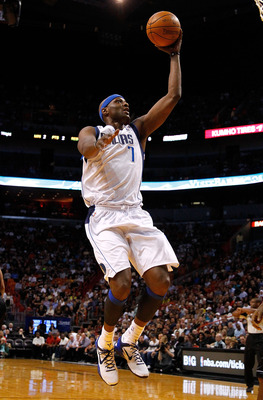 MIAMI, FL - MARCH 29: Lamar Odom #7 of the Dallas Mavericks drives to the basket during a game  against the Miami Heat at American Airlines Arena on March 29, 2012 in Miami, Florida. NOTE TO USER: User expressly acknowledges and agrees that, by downloadin