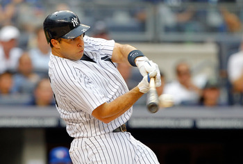 NEW YORK, NY - JULY 18:  Mark Teixeira #25 of the New York Yankees connects on a third inning single against the Toronto Blue Jays at Yankee Stadium on July 18, 2012  in the Bronx borough of New York City.  (Photo by Jim McIsaac/Getty Images)