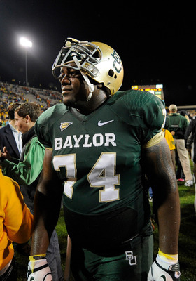 Dec 3, 2011; Waco, TX, USA; Baylor Bears center Philip Blake (74) walks off the field after the game against the Texas Longhorns at Floyd Casey Stadium. Baylor won 48-24. Mandatory Credit: Jerome Miron-US PRESSWIRE