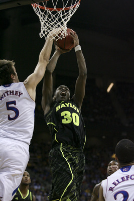 KANSAS CITY, MO - MARCH 09:  Quincy Miller #30 of the Baylor Bears shoots over Jeff Withey #5 of the Kansas Jayhawks during the semifinals of the Big 12 Basketball Tournament March 09, 2012 at Sprint Center in Kansas City, Missouri. (Photo by Ed Zurga/Get