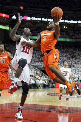 LOUISVILLE, KY - FEBRUARY 13:  Dion Waiters #3 of the Syracuse Orange shoots the ball while defended by Gorgui Dieng #10 of the Louisville Cardinals during the Big East Conference game at KFC YUM! Center on February 13, 2012 in Louisville, Kentucky.  (Pho