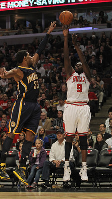 CHICAGO, IL - DECEMBER 20: Loul Deng #9 of the Chicago Bulls puts up a shot against Danny Granger #33 of the Indiana Pacers at the United Center on December 20, 2011 in Chicago, Illinois. The Bulls defeated the Pacers 93-85. NOTE TO USER: User expressly a
