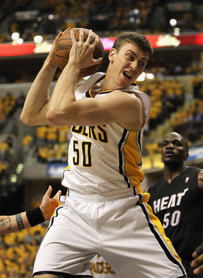 INDIANAPOLIS, IN - MAY 24:  Tyler Hansbrough #50 of the Indiana Pacers rebounds against the Miami Heat in Game Six of the Eastern Conference Semifinals in the 2012 NBA Playoffs at Bankers Life Fieldhouse on May 24, 2012 in Indianapolis, Indiana.The Heat d