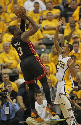 INDIANAPOLIS, IN - MAY 24: Dwyane Wade #3 of the Miami Heat puts up a shot over George Hill #3 of the Indiana Pacers on his way to a game-high 41 points in Game Six of the Eastern Conference Semifinals in the 2012 NBA Playoffs at Bankers Life Fieldhouse o