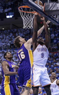 OKLAHOMA CITY, OK - MAY 16:  Serge Ibaka #9 of the Oklahoma City Thunder shoots as Pau Gasol #16 of the Los Angeles Lakers defends in Game Two of the Western Conference Semifinals during the 2012 NBA Playoffs on May 16, 2012 at the Chesapeake Energy Arena