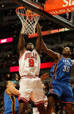 CHICAGO - JANUARY 04: Loul Deng #9 of the Chicago Bulls is fouled while shooting by Kevin Durant #35 of the Oklahoma City Thunder at the United Center on January 4, 2010 in Chicago, Illinois. The Thunder defeated the Bulls 98-85. NOTE TO USER: User expres